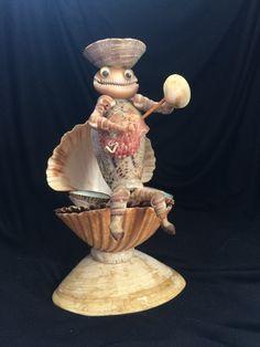 """7"""" Seashell musician folk art piece.  musician lifts up for hidden storage under shell.  $4 Coast 101 Estate Sales. 7/15"""