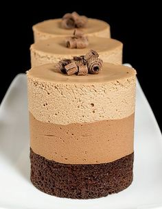 Triple Chocolate Mousse Cake Recipe - - What if your chocolate cake has three chocolate layers instead of one? Then, we are talking about one of the most decadent chocolate cakes – Triple Chocolate Mousse Cake. Chocolate Cream Cake, Triple Chocolate Mousse Cake, Decadent Chocolate Cake, Love Chocolate, Chocolate Desserts, Chocolate Mouse Cake, Nutella Mousse, Chocolate Trifle, Raspberry Chocolate