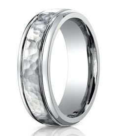 Men's Benchmark Titanium Wedding Ring with Hammered Finish - Truly unique and contemporary, this 7mm Benchmark hammered-finish ring really catches the eye! Polished on either side, the face of this men's aircraft grade titanium wedding ring is hammered for a handcrafted look. The interior is a traditional fit.