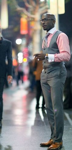 Now that's an interesting square cut on the vest. Fantastic tie to compliment the pink shirt, too. Notice the shoes and the straps on the watch. Now that's an interesting man in ANY gathering!