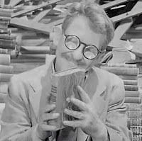 """Not a movie, but a famous TV show: The Twilight Zone's """"Time Enough at Last"""" (1959) featured a bookworm delighted to find after a nuclear holocaust that he had all sorts of time to read all the books he wanted."""