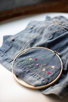 DIY Embroidered Embellished Jean Jacket by Anne Weil of Flax & Twine Fabulous DIY embellished jean jacket for a unique, personalized back to school wardrobe staple. A combo of applique patches + hand embroidery make it custom Embroidery On Clothes, Embroidered Clothes, Embroidery Fashion, Hand Embroidery, Embroidered Jacket, Diy Embroidered Jeans, Denim Jacket Embroidery, Diy Embroidery On Jeans, Embroidery Stitches
