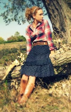 plaid + skirt + belt + boots. Pattern and hairstyle draw the eye up to the face. The boots are understated fun!