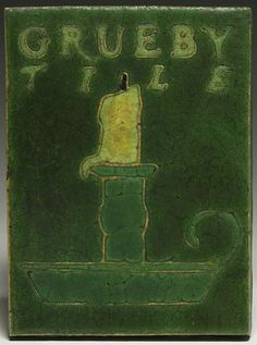 "Grueby tile sign, incised and painted chamberstick in green and yellow, has its original paper label, 4.5"" x 6""  