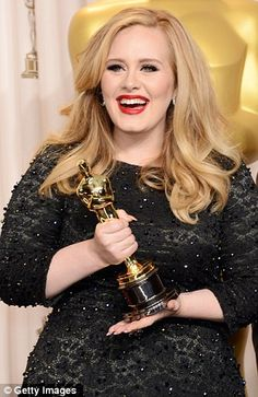 Adele - what gorgeous red lips (and we love seeing her with her hair loose too!)