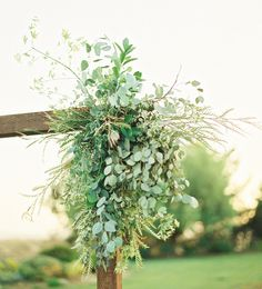 Another option, simple green focal point with one or two types of greens down either side Wedding Flowers, Wedding Ceremony Flowers