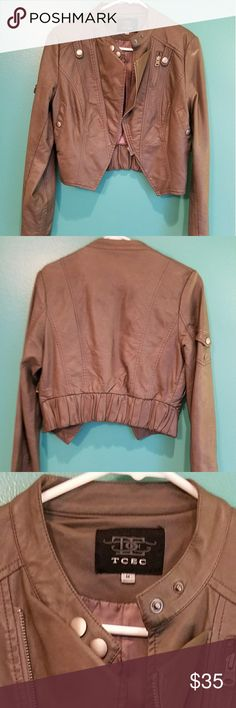 Olive/Gray Cropped Faux Leather Motorcycle Jacket Size Medium Olive/Gray faux leather motorcycle jacket. Excellent used condition. Only worn a hand full of times. Silver metal accents and zippers with elastic waist on back. Really cute over dresses and with jeans. TCEC Jackets & Coats