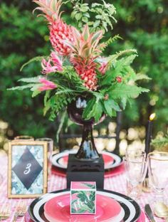 unbelievable house plant with green and pink leaves.  Selena Marie Events was featured on Green Wedding Shoes today Check out this unbelievable pink pineapple table decor so gorgeous Aloha bridal shower inspiration Photo by Megan Welker Design