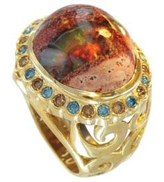 """The """"Volcánico"""" collection from Vicente Agor includes this unique 18k gold ring with Mexican fire opal surrounded by .82 carats of fancy colored diamonds. Other opal rings with white diamonds and orange sapphires are available. (415) 863-1770"""