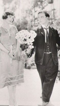 tgreywolfe1:  Buster Keaton, Renee Adoree, and daisies. Perfect.