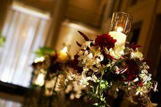 Candle votive + flowers centerpiece.