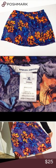 """French Connection Hawaiian Floral Skirt XL Brand : French Connection    Condition : Excellent condition    Materials: Rayon    Item Specific: Print Floral    Color: Purple , orange    Measurements: Waist 17"""" , Length 18""""    Size: XL    Color - Color can be subjective, and can also be viewed differently on different monitors. I try to best represent the color, but the color in real life may not always be the exact color on the screen. French Connection Skirts Midi"""