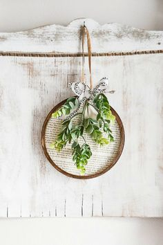 Spring Wreath: Made From Embroidery Hoops & Book Pages Are you looking for an easy way to create a spring wreath? Click over to see how easy it is to make with embroidery hoops and old book pages! Diy Spring Wreath, Spring Crafts, Diy Wreath, Wreath Ideas, How To Make Wreaths, Crafts To Make, Embroidery Hoop Decor, Embroidery Ideas, Diy Wood Wall