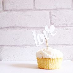 super simple vanilla cupcake with white chocolate frosting.