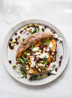 Serves Switch up your classic baked spud with Jo Pratt's bejewelled sweet potato recipe, scattered with feta, pomegranate seeds and pistachios. Recipe from The Flexible Pescatarian by Jo Pratt (White Lion Publishing). Photography by Susan Bell. Sweet Potato Recipes, Veggie Recipes, New Recipes, Vegetarian Recipes, Veggie Meals, Favorite Recipes, Healthy Recipes, Protein Recipes, Healthy Sweets