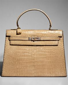 A girl can dream...So pretty but its price of a used car.  Hermes Beige Glazed Crocodile Kelly 32cm GHW   $15,499.00