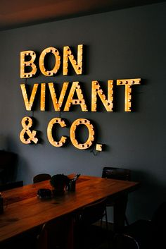 Bon Vivant & Co. | Madrid. Could do this with a last name or one word on a wall and in a room that can handle a statement.