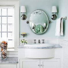 Dropped vanity height under window, round mirror with sconces and towel bar (too high?)