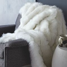 on couch in living room - Faux Fur Brushed Tips Throw #westelm