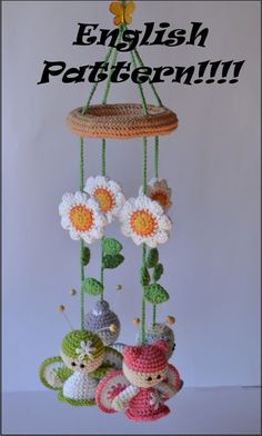 Amigurumi World: English Pattern Mobile!! Flowers & butterflies. This is a for purchase pattern. Original is in Spanish.