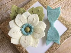 This darling felt flower and bow hair clip set is the perfect accessory for your sweet girl. Details: * set of 2 hair clips: 1 flower and a matching bow * made of high quality wool blend felt * each hair clip consists of a partially covered, single-pronged, 1 3/4 (4.75cm) alligator