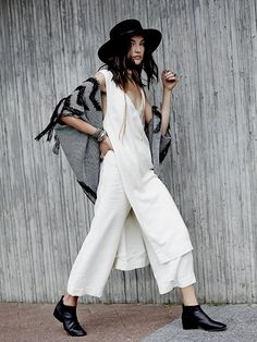 $128 Breezin On By Set   Lightweight cotton set featuring a sleeveless tunic top with exaggerated side slits and flat front gaucho style pants.  Both have exposed wooden button detailing.