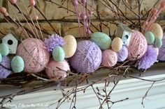 Yarn and eggs and little bird houses as a display!
