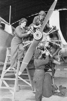 WAAF Flight Mechanics carrying out an inspection of an Oxford training aircraft.