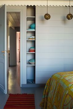 cf7d0184ca7 On the other side of the room is a concealed wardrobe with a sliding door -