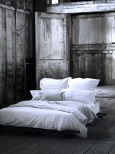 White linens and weathered wood..  down bed n pillows.. crispy Cotton 500 ct. sheets n bedding a must in any rustic roomy setting! *****