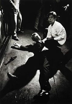 Busboy Juan Romero, 17, comforts Robert F. Kennedy moments after Kennedy was shot in the pantry of the Ambassador Hotel kitchen.  1968.