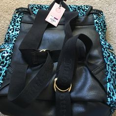 Juicy backpack Bright sequins new never been used. Color blue and black gold. Juicy Couture Bags Backpacks