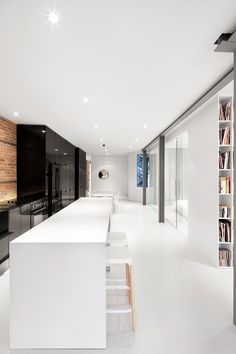 Anne Sophie Goneau design - the open kitchen is the focal point of the space - it unfolds on the dining room and living room