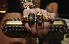 I should convince my dad to buy me this A. McQueen knuckle clutch saying I could use it as defense :P