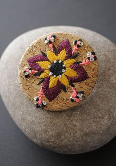 Embroidered brooch on cork by MinaSmoke