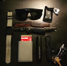 Black and olive themed EDC  submitted by Jonathan Losada  Benchmade Mini Griptilian  Kent 20T Folding Comb  DSPTCH Keychain  Retro superfuture sunglasses  Secrid Slim Wallet  Apple Watch 42mm  Nike Lab ACG  Apple EarPods  Juno power