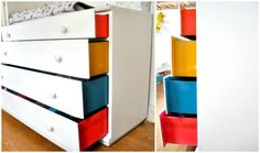 A white dresser with bursts of color on the sides of the drawers.