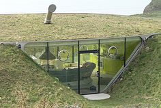 The Malator House, Pembrokeshire,  England. It's carved out of a hillside and shaped like a tunnel, but its glass-fronted design allows it to be bathed in masses of light.