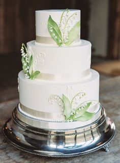 Three tier greenery wedding cake: http://www.stylemepretty.com/2017/02/01/these-lovebirds-were-brought-together-by-their-four-fur-babies/ Photography: Natalie Watson - http://nataliewatsonphotography.com/