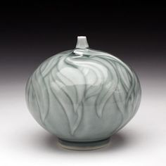 Elaine Coleman. I like this grey glaze. It's subtle, like the leaves in winter on a grey day after the snow.