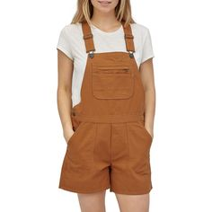 evo.com   Patagonia Overalls > Get after it this spring and summer in the Patagonia Stand Up Overalls. Gardening has never looked this good. Adjustable Straps with Sliders Fit Most Torso Lengths Regular Fit Neither slim nor oversized. Regular-fitting technical garments may be worn over heavier midlayers. 9.5-oz 100% Organic Cotton Canvas Traditional Overall Bib in a Short-length Version with Stand Up Pocket Details Center Front Patch-on Pocket with Secure Zipper Section and Two Drop-in Spaces Work Overalls, Overalls Outfit, Overalls Women, Overall Shorts Outfit, Brown Pants, Garden Seeds, Short Outfits, Evo, Patagonia