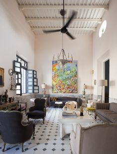 In the soaring living room of Casa Serrano Willson, which belongs to the co-owners of the Los Angeles furniture gallery Downtown, a painting by Mérida artist Irvim Victoria injects vibrant color.