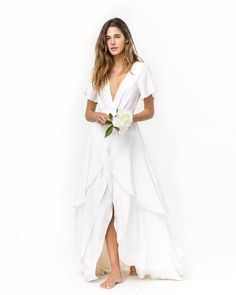 Especially if you are planning a destination wedding, nothing sounds more unappealing than schlepping 20 pounds of tulle to the beach.  If you still want something vaguely bridal, try a style like this flowy and casual wedding dress.