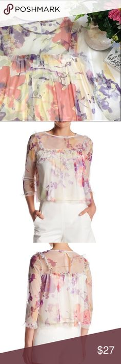 ✨HP✨ Mimi Chica Lined Sheer Floral Top This top has spring written all over it!  The top is made of a 100% polyester beautiful sheer floral fabric in ivory, purple, coral, yellow & greens.  The body of the top is completely lined in a silky poly fabric.  The front has a adorable ruffle and pleated detail that is carried to the back.  The neck is a crew neck with keyhole with an overhead loop & button entry.  The top is designed to hit at the natural waist.  Sleeves are 3/4 length with…