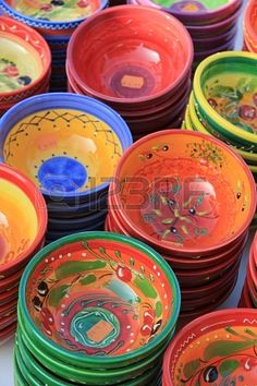 Pottery in traditional Provencal colors and patterns at a market in the Provence