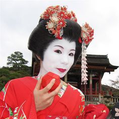 Geisha with Ball of Whacks in Kyoto, Japan