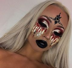 Use glitter and face jewels for a glamourous twist on blood tears. @katiespearpoint