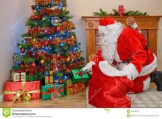 christmas presents under the tree | ... Christmas or Santa Claus putting gifts forms his sack under the tree