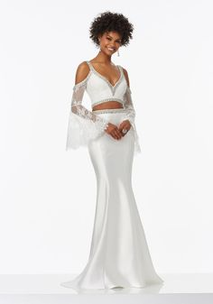 Two-Piece Prom Dress with Long Sleeved Beaded Lace Top and Larissa Satin Skirt Bell Sleeves Accented with Eyelash Lace Exposed Shoulders and Deep V-Neckline Accented in Jeweled Beadwork Zipper Back Closure Colors Available: White    Morilee Prom