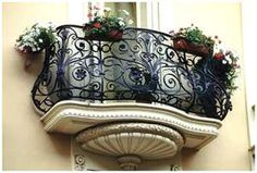Wrought iron balconies are my favorite...